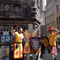 Storyteller Callum Lykan, Robert the Bruce cut-out and Chris Rutterford outside the Scottish Storytelling Centre on the Royal Mile in Edinburgh.