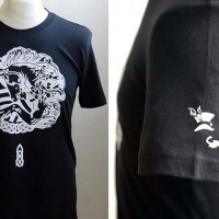 Black unicorn t-shirt with white design and left sleeve detail