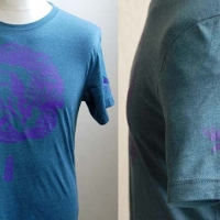 Blue unicorn t-shirt with purple design and left sleeve detail