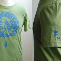 Green unicorn t-shirt with blue design and left sleeve detail