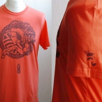 Orange unicorn t-shirt with burgundy design and left sleeve detail