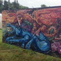 Dragon and a unicorn spray work mural live-painted at the 2017 Kelburn Garden Party festival.