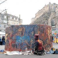 Chris painting his Porteous Riots mural in the Grassmarket, in the shadow of Edinburgh Castle.