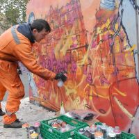 Elph live painting his riot mural in the Grassmarket.
