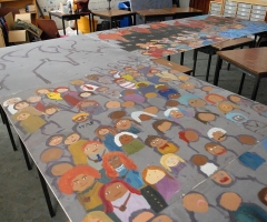 The evacuees mural laid out for painting.