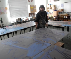 Chris laying out the evacuees mural in the classroom.