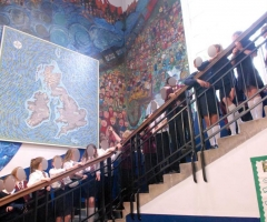 Students take in the mural during the post-break unveiling.