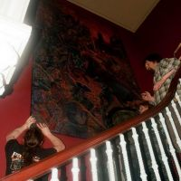Hanging the finished painting at the Clanranald Trust for Scotland in Callander.