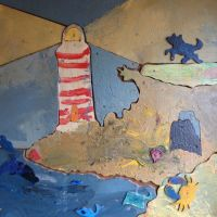 Lighthouse on the wall of the play hut.