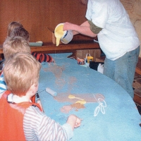 Pouring paint with the kids.