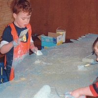Working on the mural in the play hut.