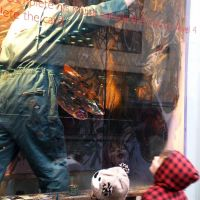Chris painting in one of John Lewis's shop windows.