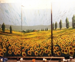 La Favorita sunflower mural in progress.