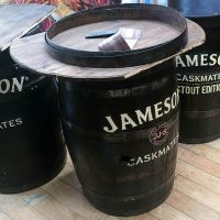 Hand-painted Jameson Whiskey barrel tables.