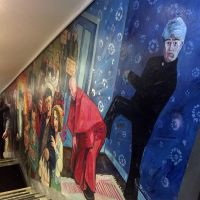 Detail of the Father Ted mural on the staircase.