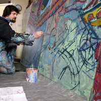 Chris working on the mural