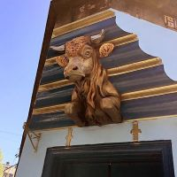 Painted cow above the door to Shipwrecked, at 30 St. Mary's Street, Edinburgh.