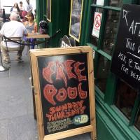 A-frame signage outside the Oz Bar in Edinburgh.