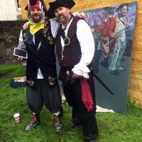 Chris (dressed as a pirate's parrot) and a member of the Clanranald Trust for Scotland at Culross Palace in Fife in 2016