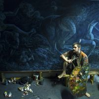 Chris with the Tam o'Shanter mural in his Edinburgh studio.
