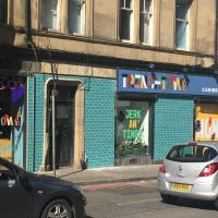 Custom exterior signage at Trenchtown Caribbean Social Club in Edinburgh.