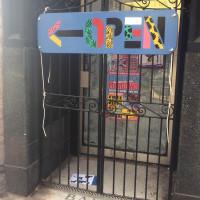 Custom exterior signage at Trenchtown Caribbean Social Club in Edinburgh.